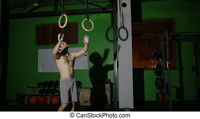 Gymnast competing on rings. street workout, CrossFit....