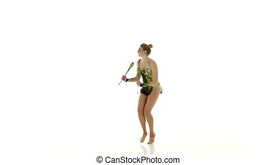 Gymnast doing a back flip and then turned with a mace. White background