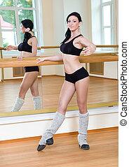 Gymnast girl doing physical exercise
