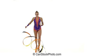 Gymnast gracefully move with a ribbon in his hands. White background
