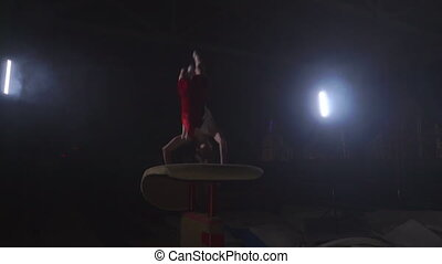Gymnast gymnastic somersault exercise HD slow-motion video....