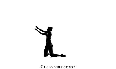 Gymnast holding a mace and professional bent. White background. Silhouette. Slow motion