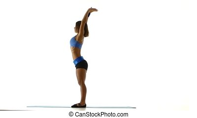 Gymnast makes a forward bend. White