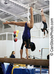 Gymnast on beam - Gymnast competing on beam