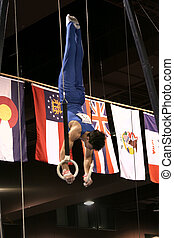 Gymnast  on rings - Gymnast competing on rings