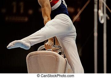 gymnast performing pommel horse in championship gymnastics