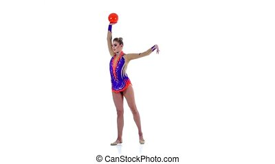 Gymnast to be turned with the ball in his hands. White background. Slow motion