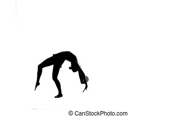 Gymnast with the ball in his hands flips forward. White background. Silhouette. Slow motion