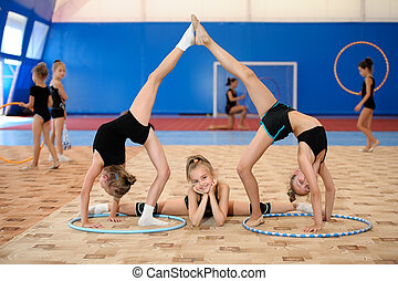 Gymnastic composition made by three girls - Young female...