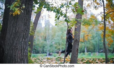 Gymnastic girls running in the autumn park. Side angle, slow...