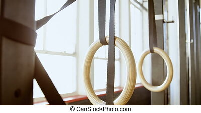 Gymnastic rings with straps in the fitness studio 4k -...