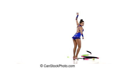 Gymnastic stunt with ribbon from the beautiful girl, slow motion