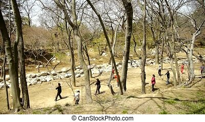 Gymnastics exercise in forest.leisure,oriental,sport,people.