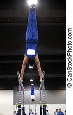 Gymnastics - Young gymnasts competing on parallel bars