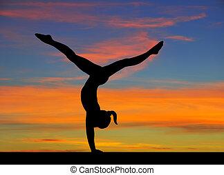 Gymnastics sky - Silhouette of a gymnast girl in balance on ...