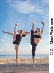 gymnasts exercising pose