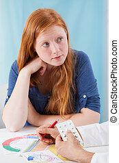 Gynaecologist prescribing young girl contraceptive pills -...