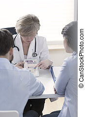Gynecologist explaining in vitro process