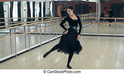 Hispanic woman dancing in the ballroom