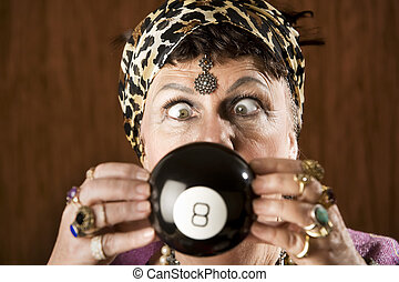 Gypsy predicting the future - Gypsy looking at an eight ball...