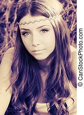 gypsy - Romantic young woman posing outdoor.