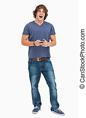 hållande cellphone, gapande, student