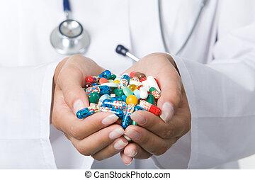 håndfuld, i, pillerne