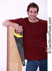 hölzern, floorboard, besitz, lehnend, säge, mann