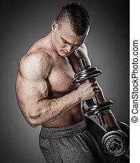 hübsch, junger, muskulös, mann- trainieren, mit, hanteln