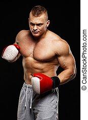 hübsch, muskulös, junger mann, tragen, boxhandschuhe