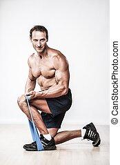 hübsch, muskulös, mann, machen, ausdehnen von übung