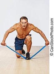 hübsch, muskulös, mann, machen, dehnen, exercise.