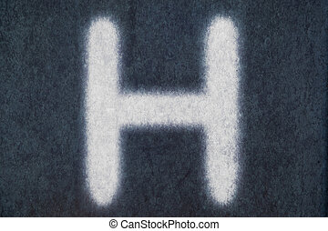 H isolated chalk letter in blackboard background
