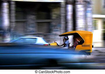 Habana Traffic - Motion blur of cocotaxi in Habana Traffic