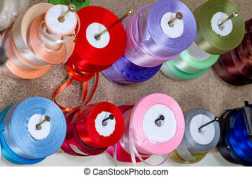 haberdashery ribbon reels rolls rows and trims in fabric retail shop sew sewing supplies for sale retail shop market