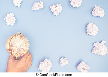 Habnd holding globe with paper cloud frame copy space