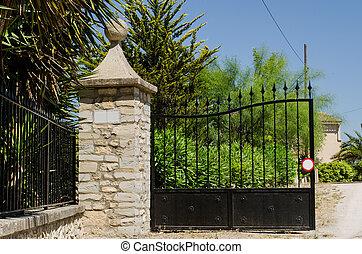 Hacienda gate - Entrance gate to a spanish hacienda on a...