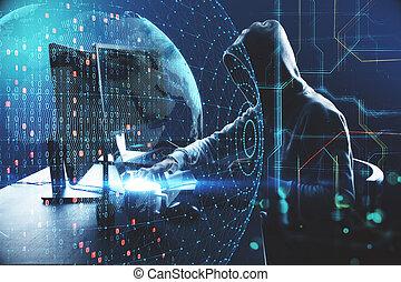 Hacker at desktop using laptop and computer