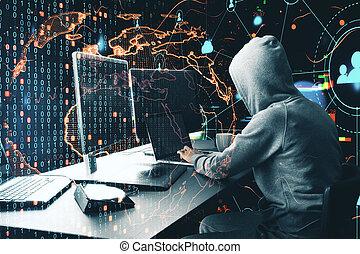Hacker at desktop using laptop with digital ear