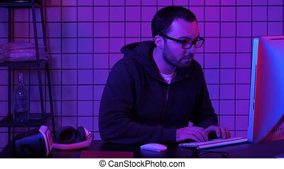 Hacker at the computer hacking. Professional shot in 4K...