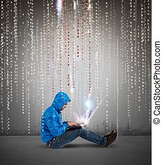 Hacker - Concept of hackering with a boy with laptop and...