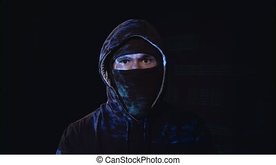 Hacker copies information from the computer. Black...