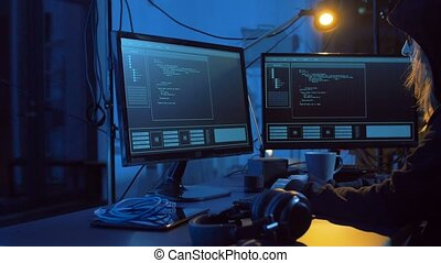hacker creating computer virus for cyber attack - cybercrime...