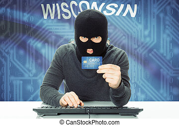 Hacker holding credit card and USA state flag on background - Wisconsin