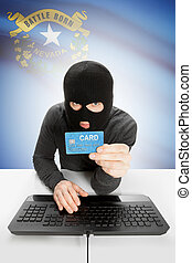Hacker in black mask with USA state flag on background - Nevada