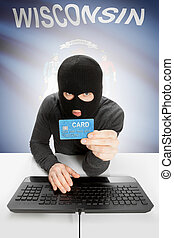 Hacker holding credit card with US state flag on background - Wisconsin