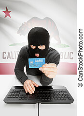Hacker holding credit card with US state flag on background - California