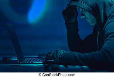 Hacker in Front of His Laptop Computer
