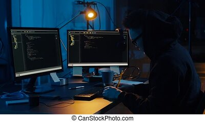 hacker in glasses using computers for cyber attack -...