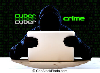 hacker man in black hood and mask with computer laptop hacking system in digital intruder cyber crime concept